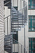 Metal spiral staircase on façade of town house