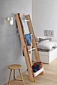 DIY, wooden ladder-style clothes rack in bedroom