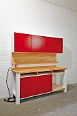 DIY workbench with red cupboard doors