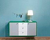 Floating sideboard with green frame