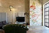 Graffiti and floral wallpaper in vintage-style living room