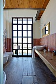 Old wooden floor and lattice window in rustic bathroom