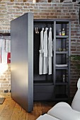 Safe-like wardrobe against brick wall