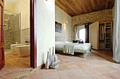 Mediterranean bathroom and bedroom with terracotta floor tiles