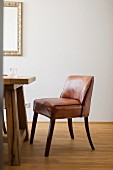 Brown leather chair at wooden table