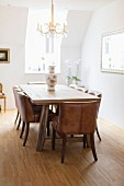 Wooden table and leather-covered chairs in classic dining room