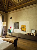 High painted ceiling and long sideboard in living room of palazzo