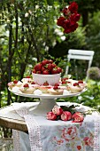 Strawberry tarts and bowl of strawberries on cake stand