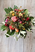 Bouquet of roses, olive branches, St. John's wort and cherry laurel