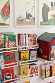 Small spice racks used as shelves for children's books