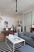 Mixture of styles and dining area in interior of period apartment