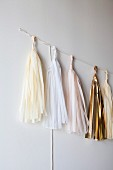 Tassels of different colours hung on wall