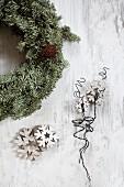 Wreath next to wooden snowflakes