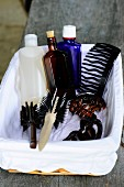 Hair brushes, combs and toiletries in white-lined basket