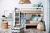 Various patterns on cube and carpet in front of bunk beds with bed ladder