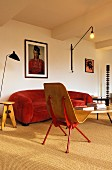 Red sofa and wall-mounted lamp in living room