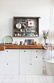 Kitchen unit made from old workbench and white cabinets