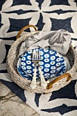 Blue and white crockery on wicker tray on patterned rug