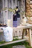 Mediterranean arrangement of ornaments on rustic wooden bench
