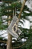 Metal ice-skate ornaments hung on Christmas tree