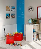 Folding table, shelves and blue chalkboard stripe in play area