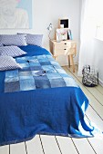 Blue blanket with patchwork detail made from old jeans
