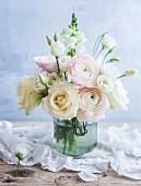 Pastel bouquet in old swing-top jar