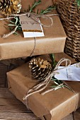 Gifts wrapped in brown paper, parcel string and hand-made gift tags