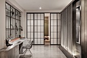 Desk in industrial loft apartment with factory windows and Shoji sliding doors