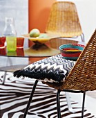 Zigzag-patterned cushion on wicker chair