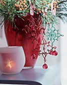 Wire, , vintage-style Christmas tree decoration hanging from pine branch