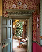 View into festive living room through antique door