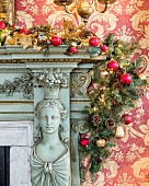 Lavishly ornamented fire surround decorated with festive garland