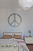 Mural of CND symbol above bed and metal bedside table