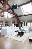 Vintage-style living room with double-height ceiling