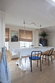Simple dining room decorated with linen fabrics in natural shades