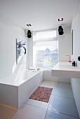 Cubist fittings in minimalist bathroom