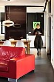 Woman walking through futuristic interior