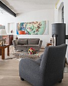Eclectic living room with various upholstered seating