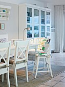 A comfortable dining area with a white cabinet in a country house-style room