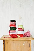 Various rolls of gift ribbon on top of rustic cabinet