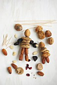 Making fantasy figurines from dried fruits and toothpicks