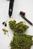 Making a bird ornament from moss