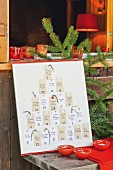 Advent calendar with hand-written, personal gift cards hand-made from paper tags
