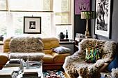 Sheepskin rugs on easy chair and sofa in artistic living room