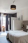 Bedroom and ensuite bathroom in shades of grey