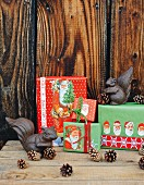 Gifts wrapped creatively in paper with Father Christmas motifs and metal squirrels