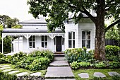 Victorian house with well-kept garden