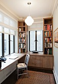 Custom fitted shelves and desk in small study