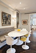 Dining table with marble top, bench and designer chairs